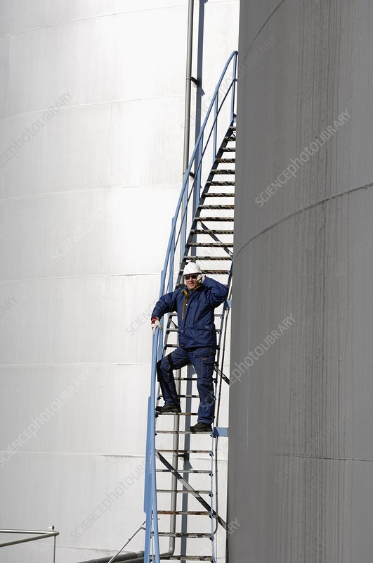 Oil worker on mobile phone