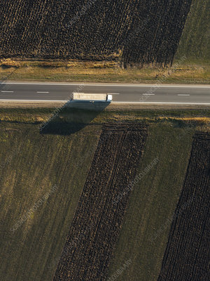Lorry on rural road, aerial view