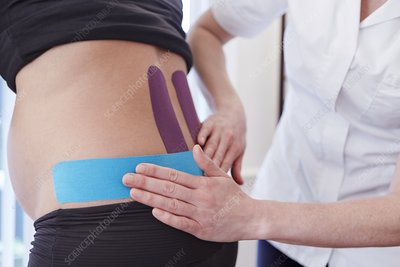 Osteopath applying tape