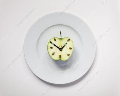 Apple half with clock hands