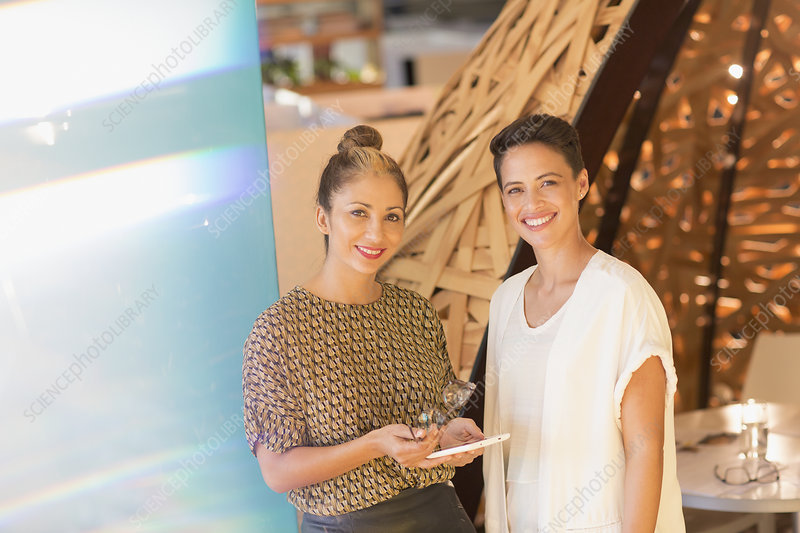 Portrait businesswomen with digital tablet