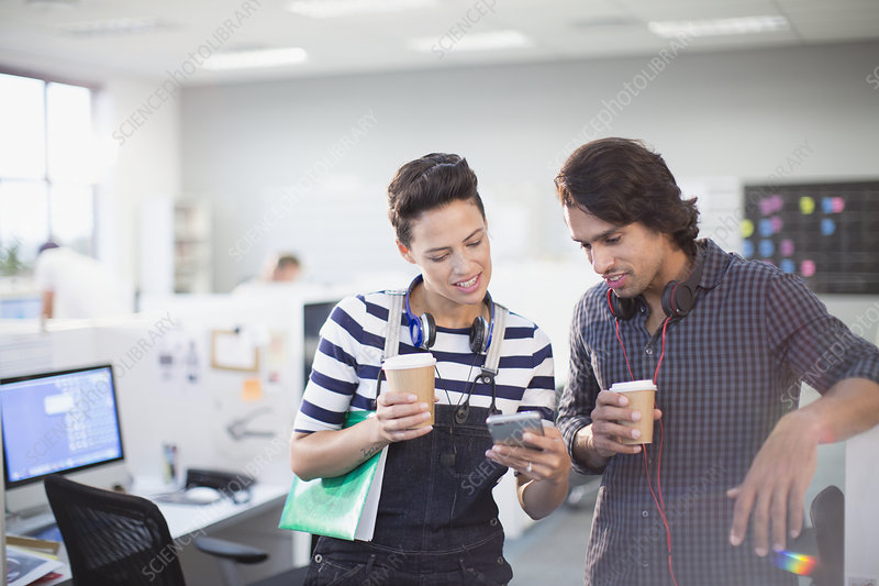 Business people drinking coffee and using smartphone