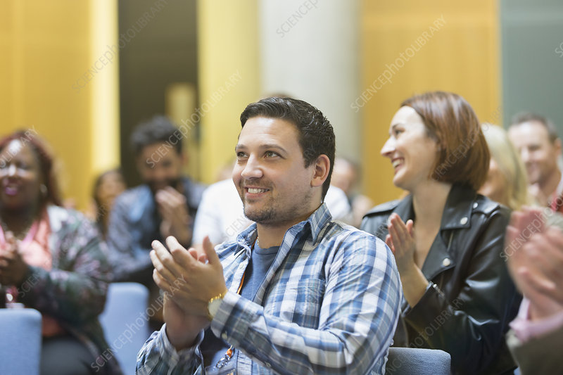 Smiling man clapping