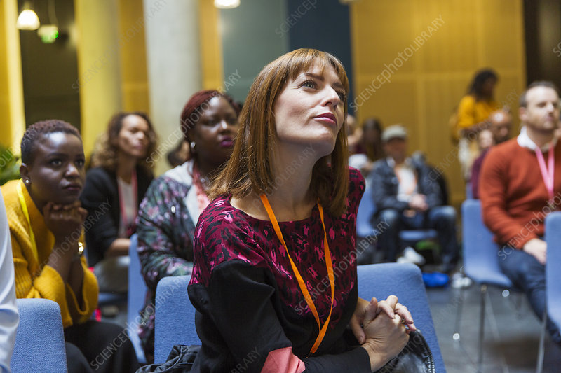 Attentive, focused businesswoman listening