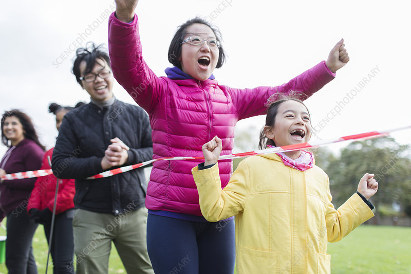 Enthusiastic family spectators cheering