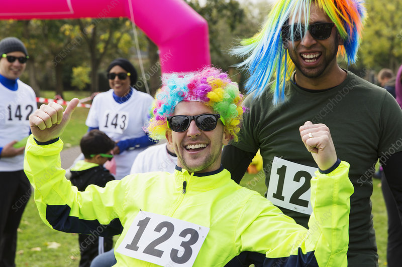 Portrait enthusiastic male runners wearing wigs