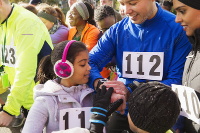 Family runners checking smart watch starting line