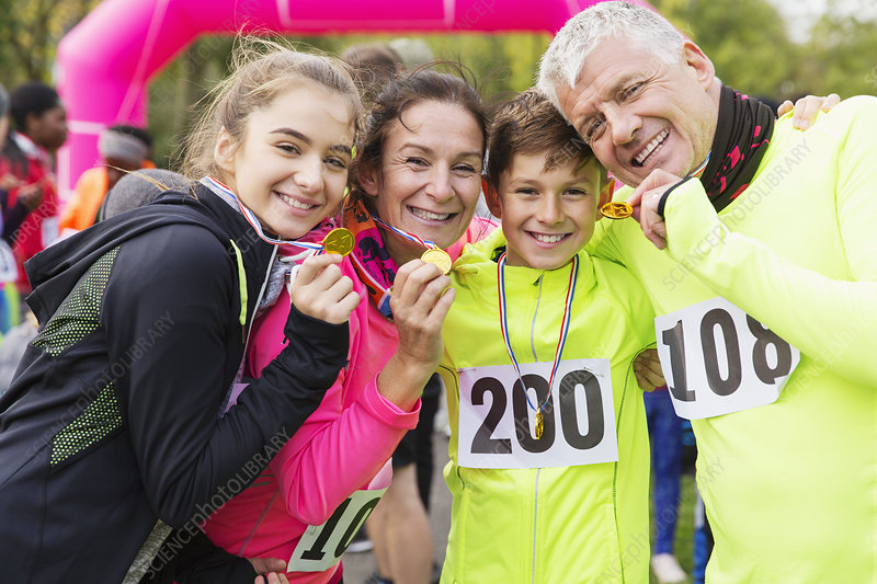 Portrait smiling, family runners showing medals