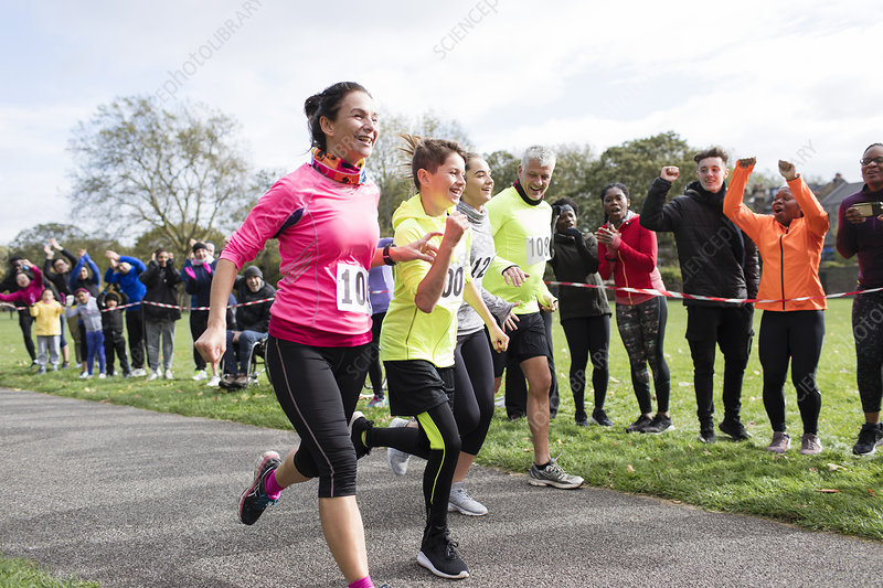 Enthusiastic family runners running in run at park