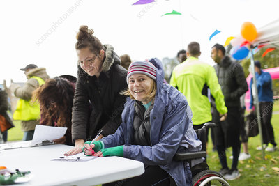 Woman in wheelchair checking in for race
