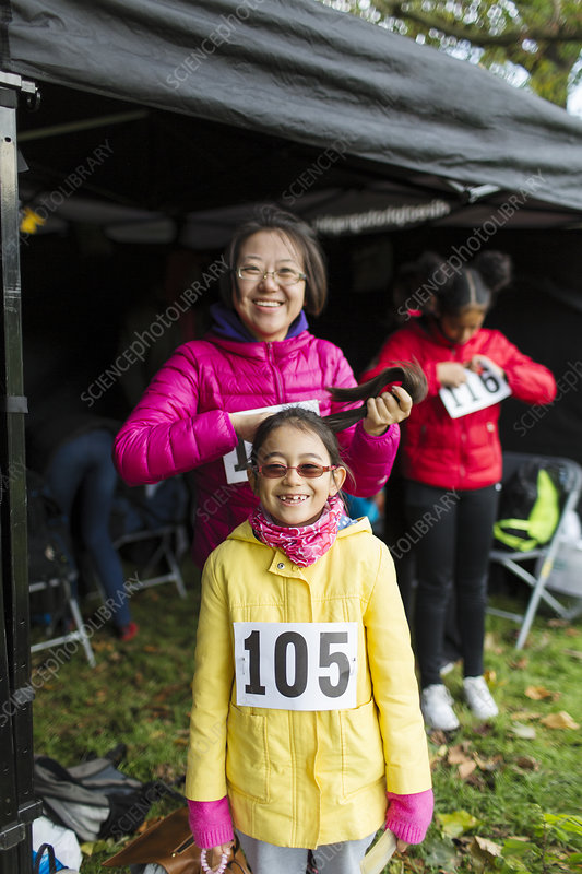 Portrait smiling, mother and daughter runners tent