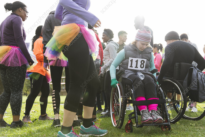 Woman in wheelchair at charity race in park
