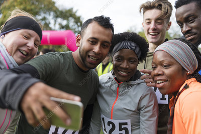 Friend runners taking selfie at charity run