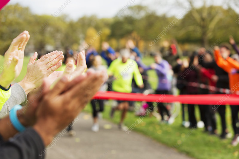 Spectators clapping for runners