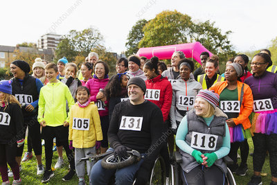 Smiling crowd at charity race in park
