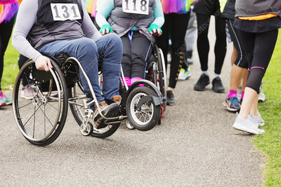 Woman in wheelchair at charity race