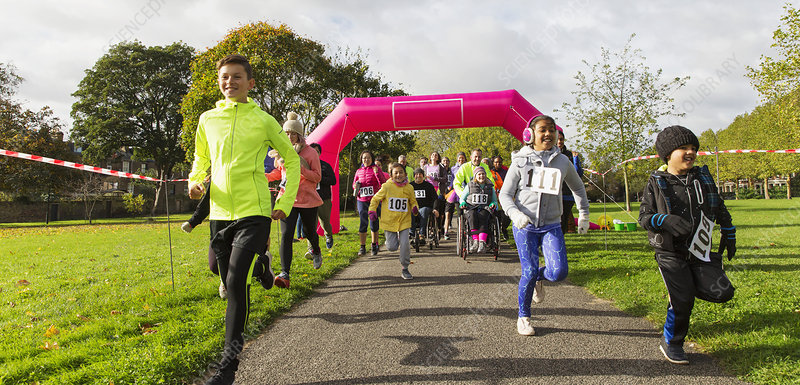 Kids running at charity run in sunny park