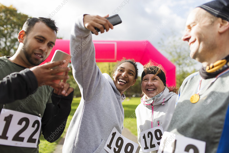 Happy runner friends taking selfie