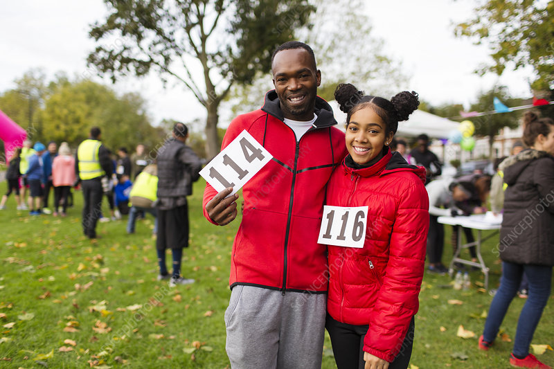 Portrait father and daughter runners