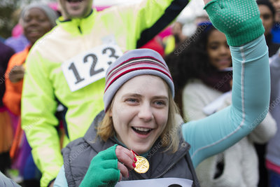 Enthusiastic woman with medal cheering