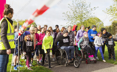 Crowd of runners and people in wheelchairs