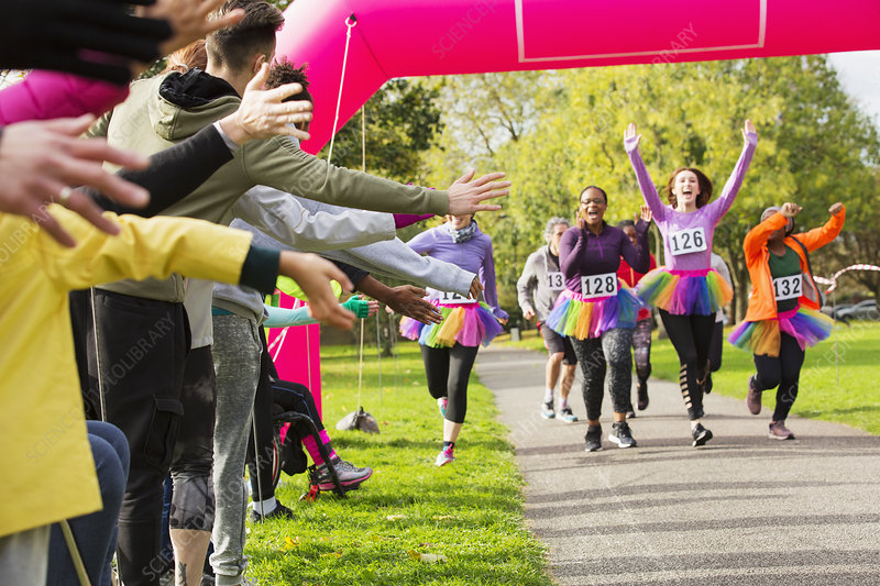 Enthusiastic runners in tutus nearing finish line