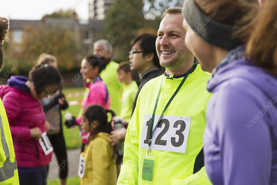 Smiling male runner at charity run