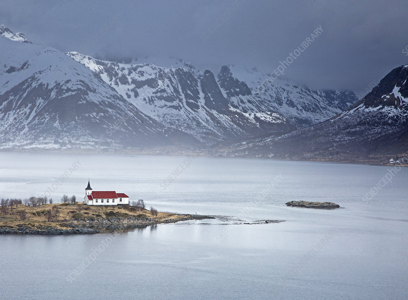 Remote church along fjord waterfront, Norway