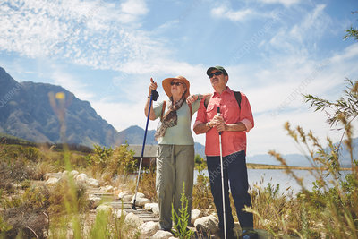 Active senior couple hiking with hiking poles