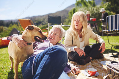 Happy active senior women and dog