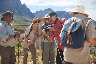 Active senior friends hiking with hiking poles