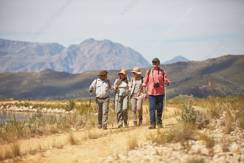 Active senior friends hiking