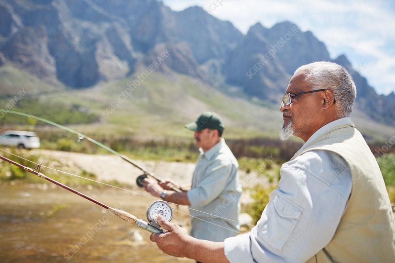 Active senior men friends fishing