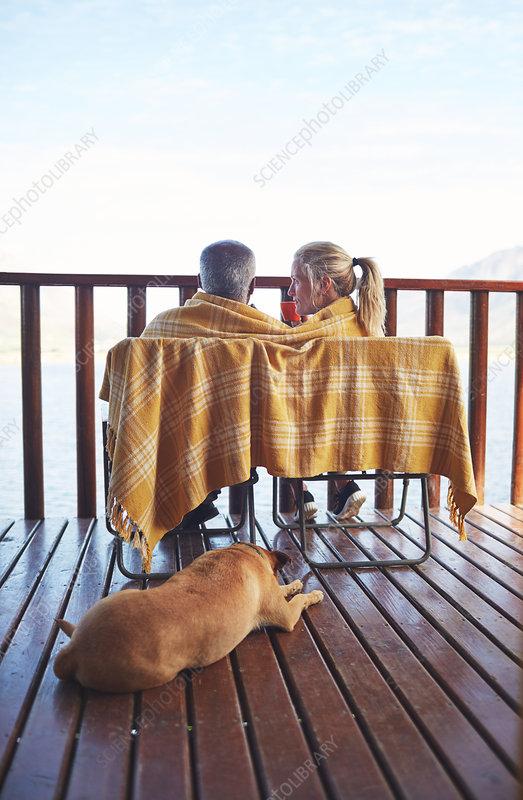 Cosy couple and dog on balcony