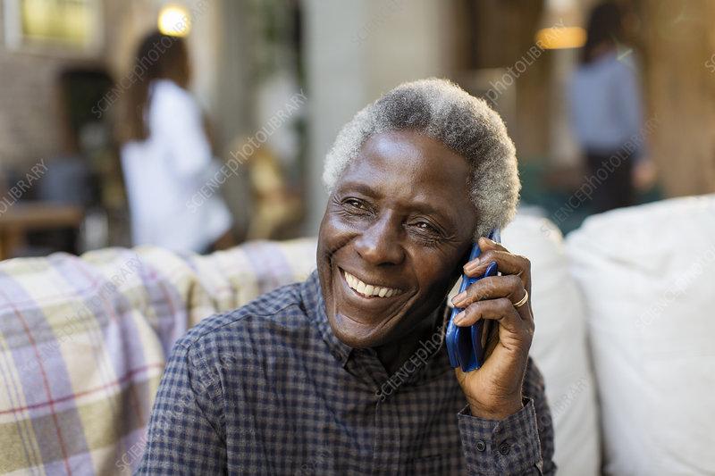 Smiling senior man talking on smart phone