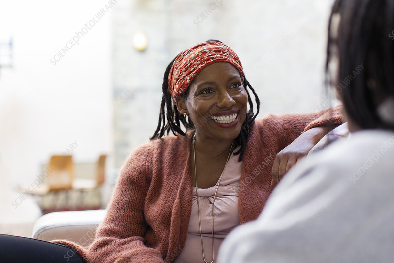 Enthusiastic woman talking with friend