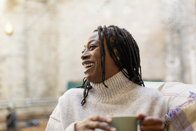Laughing, happy woman drinking coffee