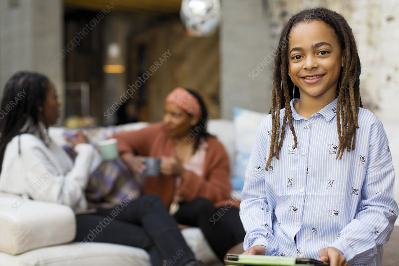 Portrait smiling girl with digital tablet