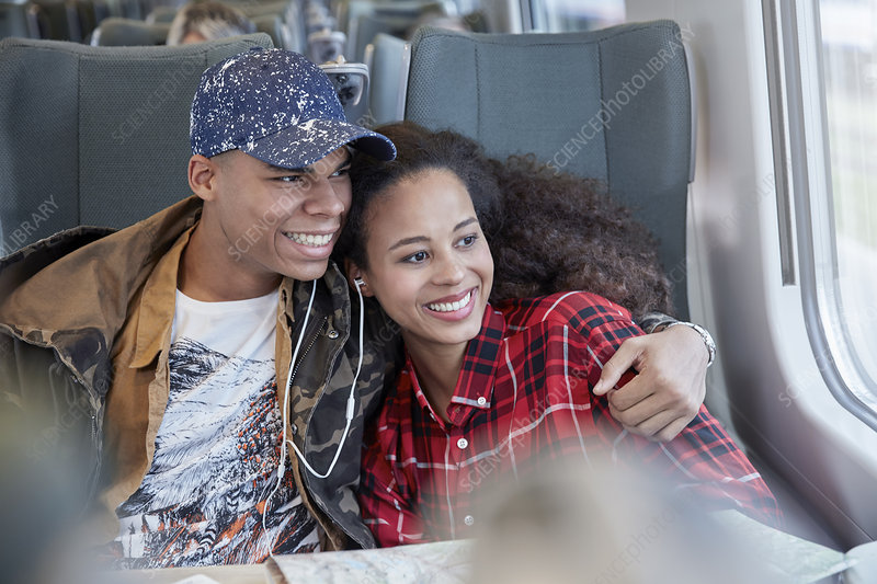 Affectionate young couple sharing headphones
