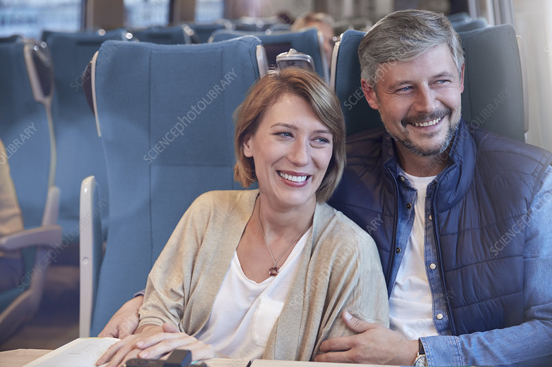 Happy couple on train