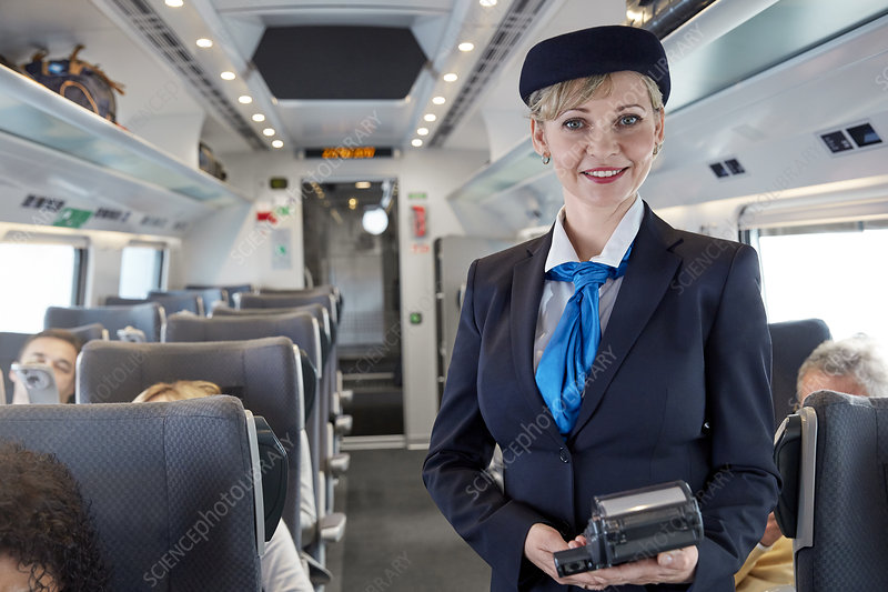 Portrait confident female attendant on train