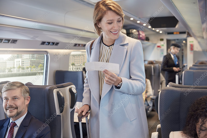 Businesswoman with ticket boarding train