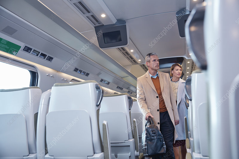 Business people boarding train