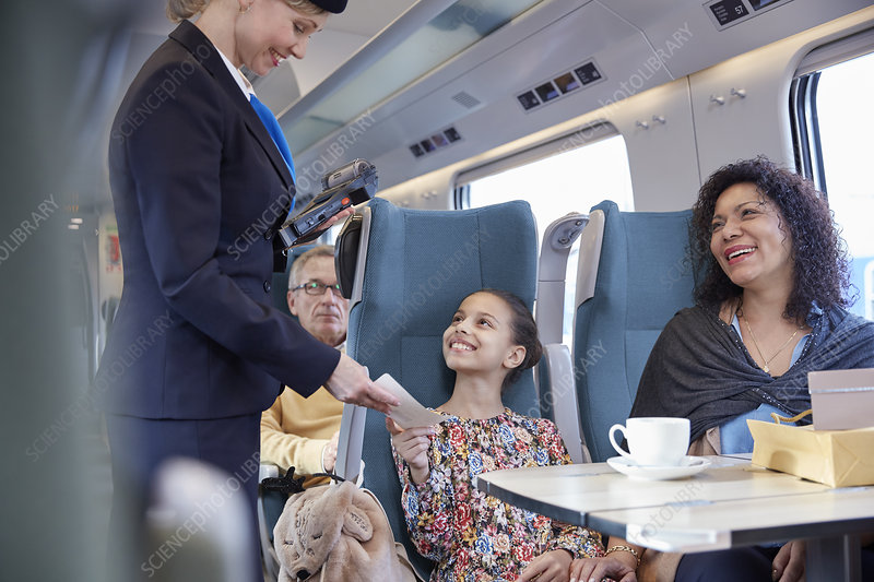 Attendant checking ticket of mother and daughter