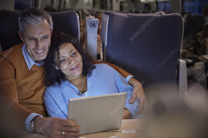 Couple watching movie on tablet on train