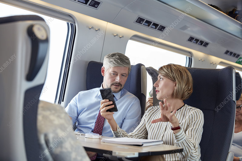 Business people working on train