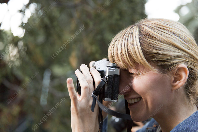Smiling woman using camera