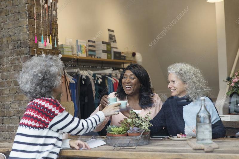Women friends drinking tea window