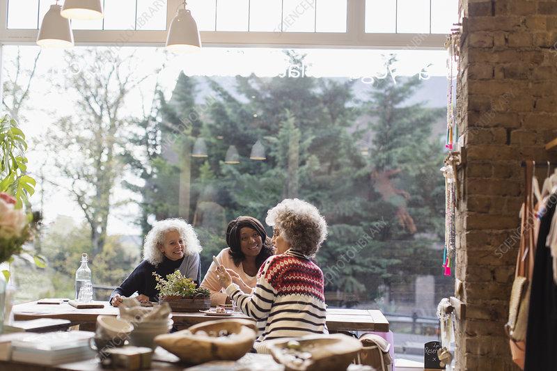 Women friends with smart phone window