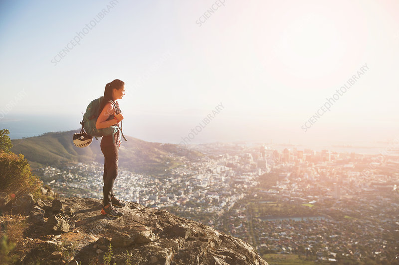 Female rock climber on top of hill